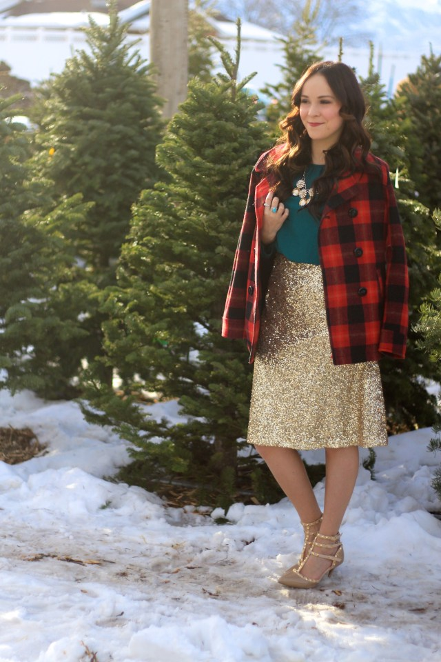 keara's christmas outfit with gold sequin skirt, green shirt, and red plaid coat