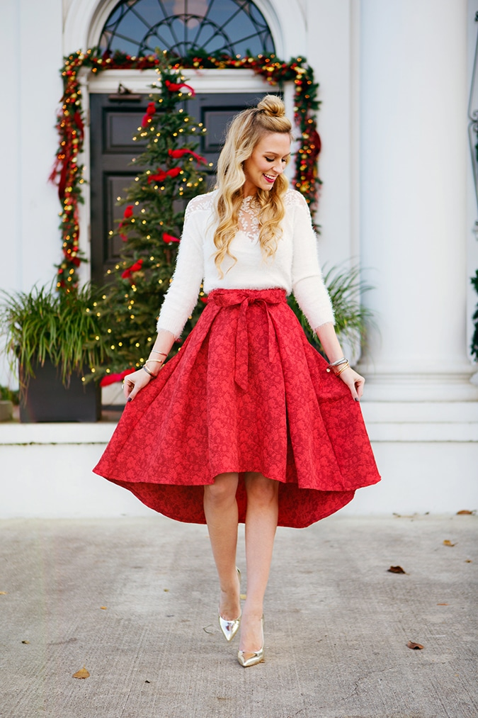 krystal faircloth's christmas outfit with red skirt and white sweater