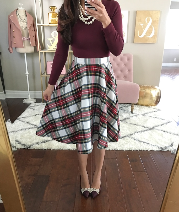 Stylish Petites's outfit with pumps, plaid skirt, and long sleeve top.