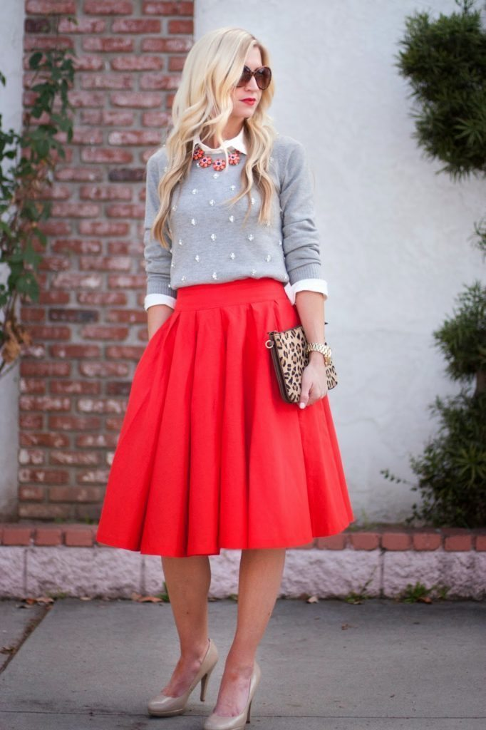 Leanne Barlow's outfit with red a line skirt, layered tops, and heels.