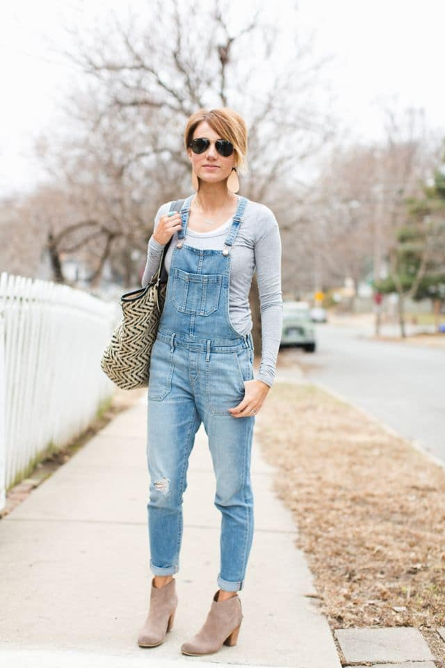 Kilee Nickels from onelittlemomma.com styles her overalls with heeled booties and a gray long sleeve tee.
