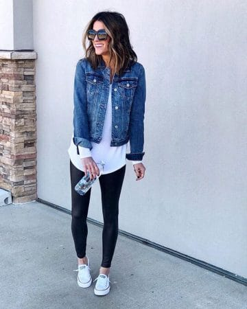 Jen Reed styled her dark jean jacket with a white shirt, white converses, and black pants.