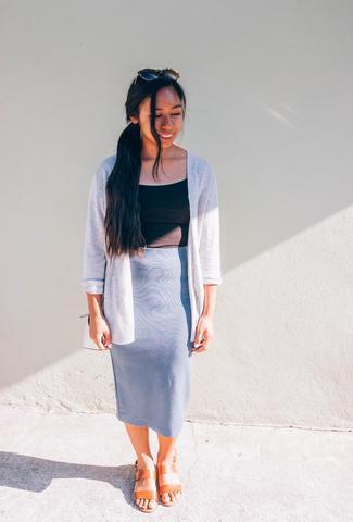 Blaze Ann wearing a gray pencil skirt