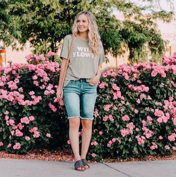 Jensyn put together an outfit with long denim shorts, sandals, and a fun t shirt.