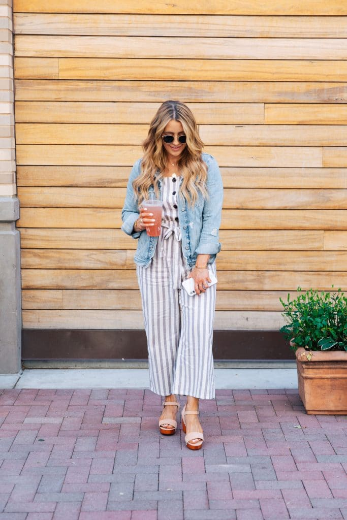 how to style a jean jacket with a jumpsuit