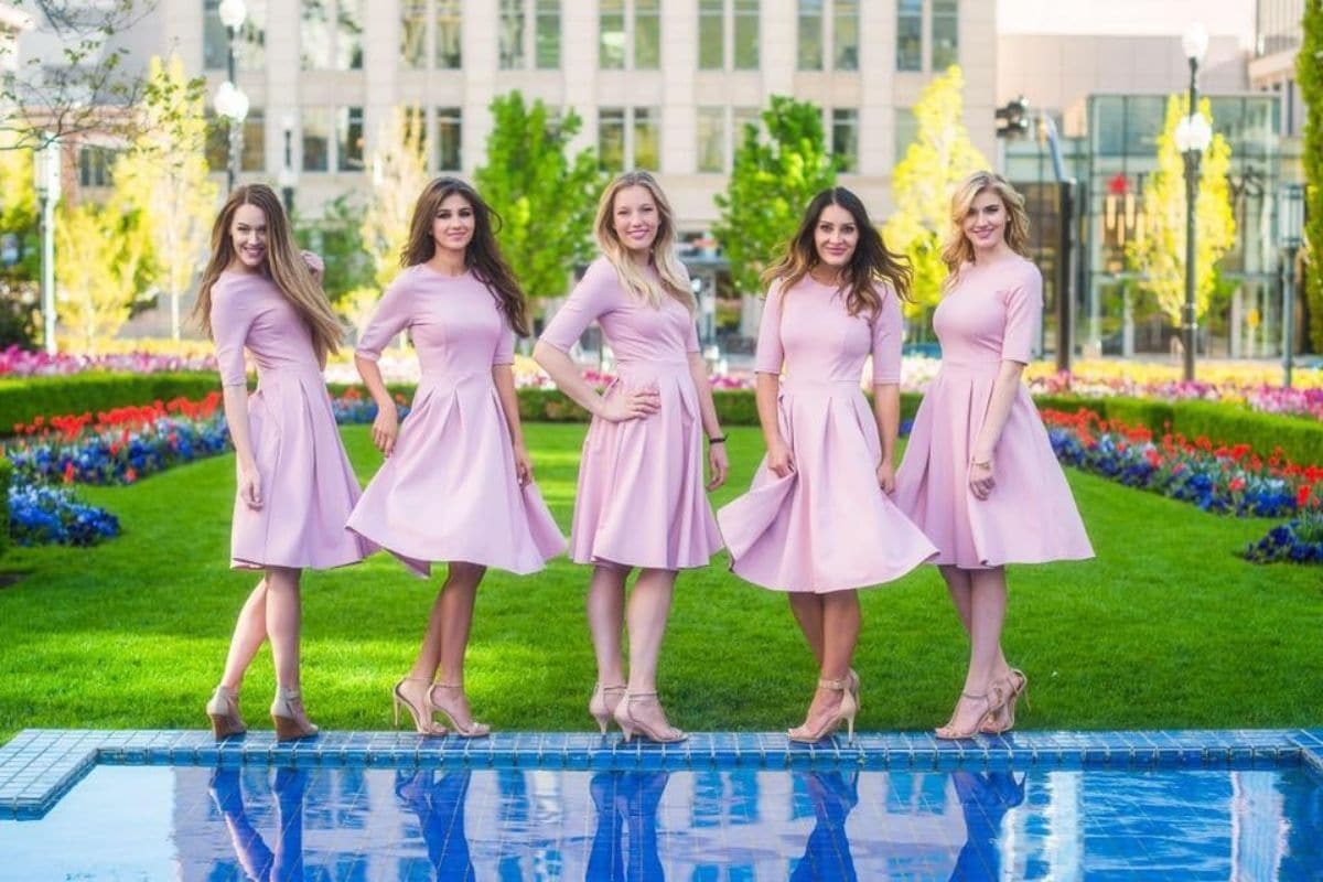 5 girls wearing pink dresses from sexy modest boutique