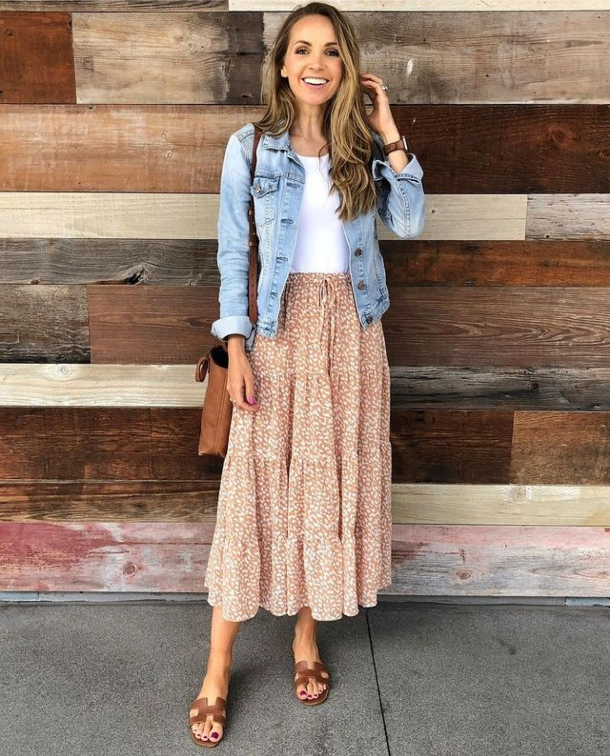 outfit with peach colored spring skirt, sandals, white top, and light denim jacket