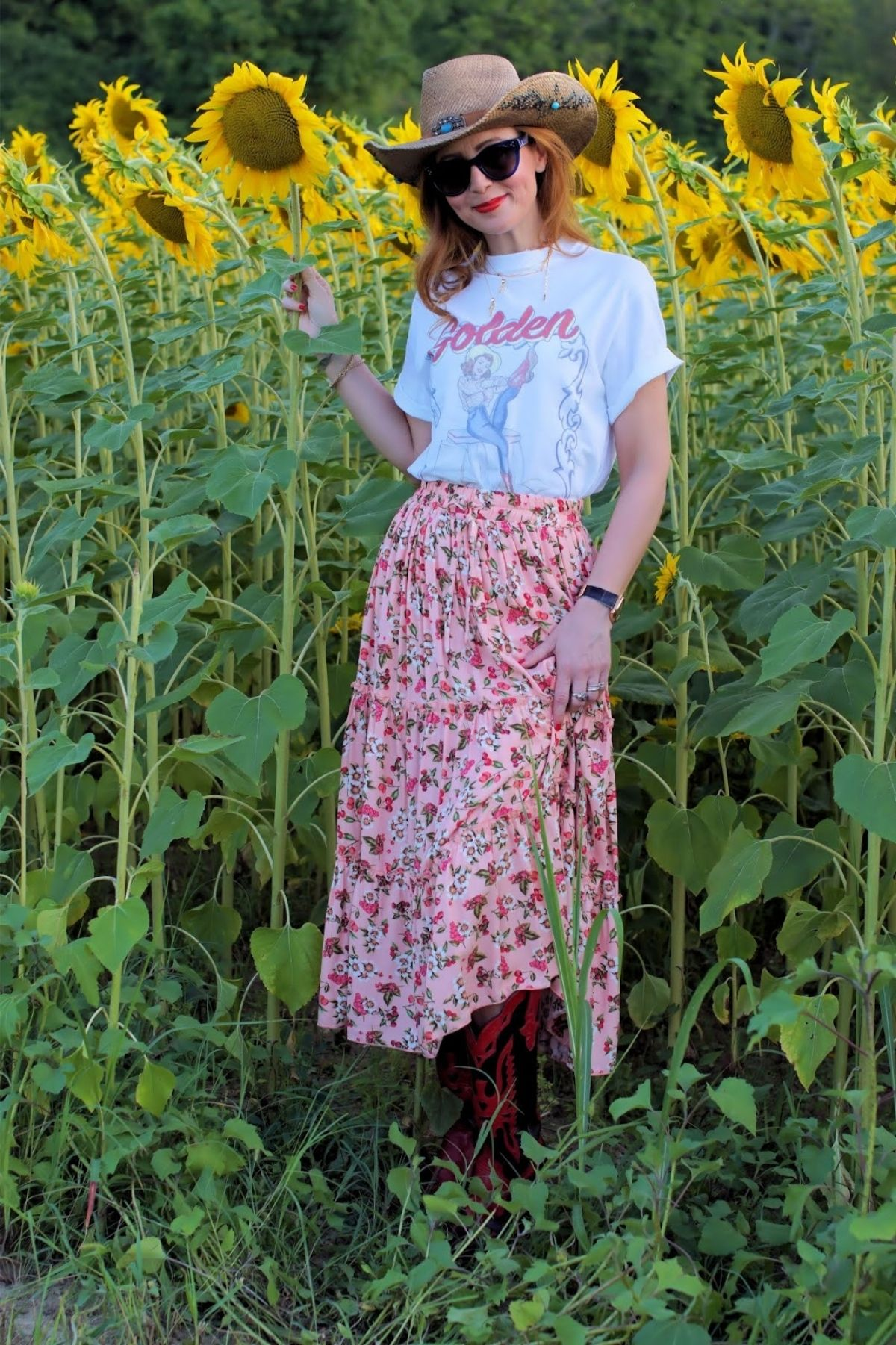 styling pint maxi skirt with short sleeve graphic tee that says golden goose on it