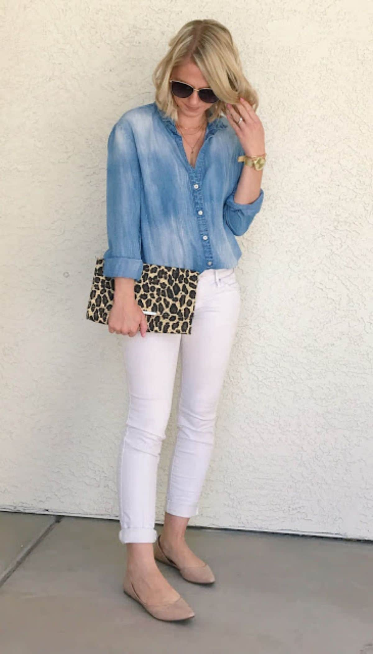 tucked chambray shirt into white jeans