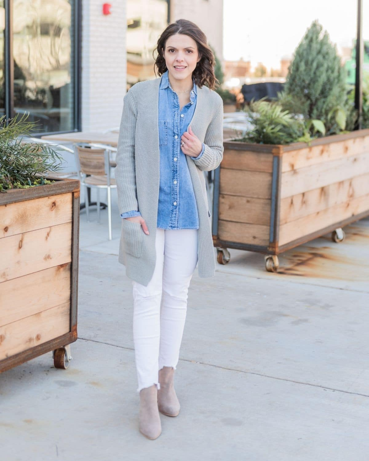 wear a chambray shirt under a gray oversized cardigan and white jeans