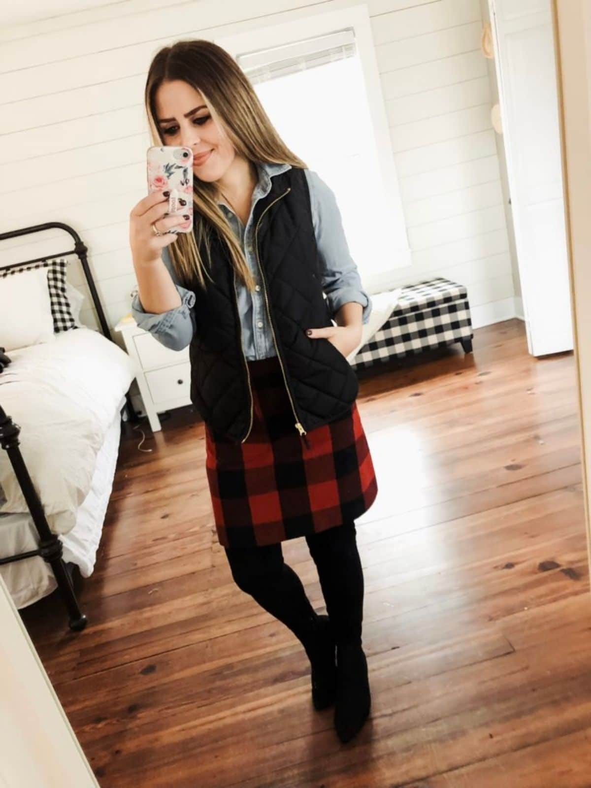 wear black vest over chambray shirt