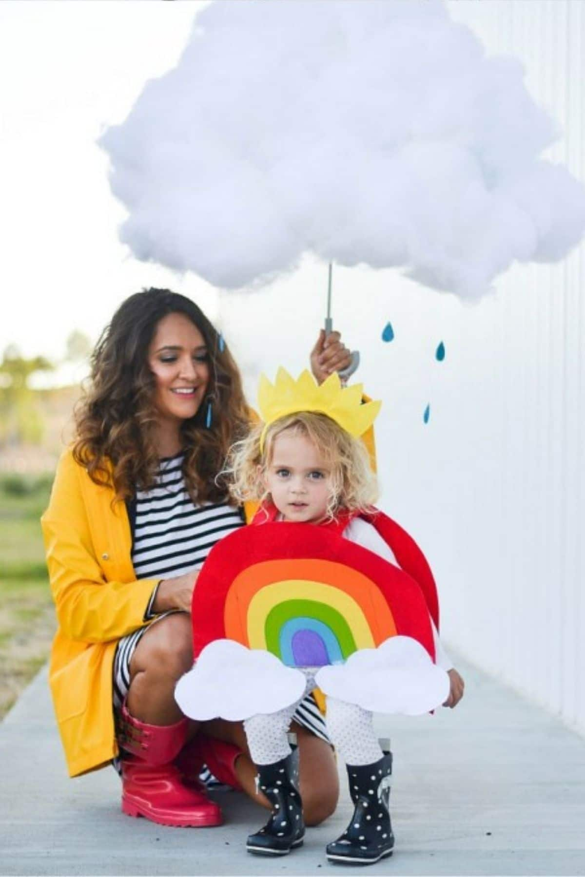 mom dressed up as a rain cloud and toddler dressed as a rainbow