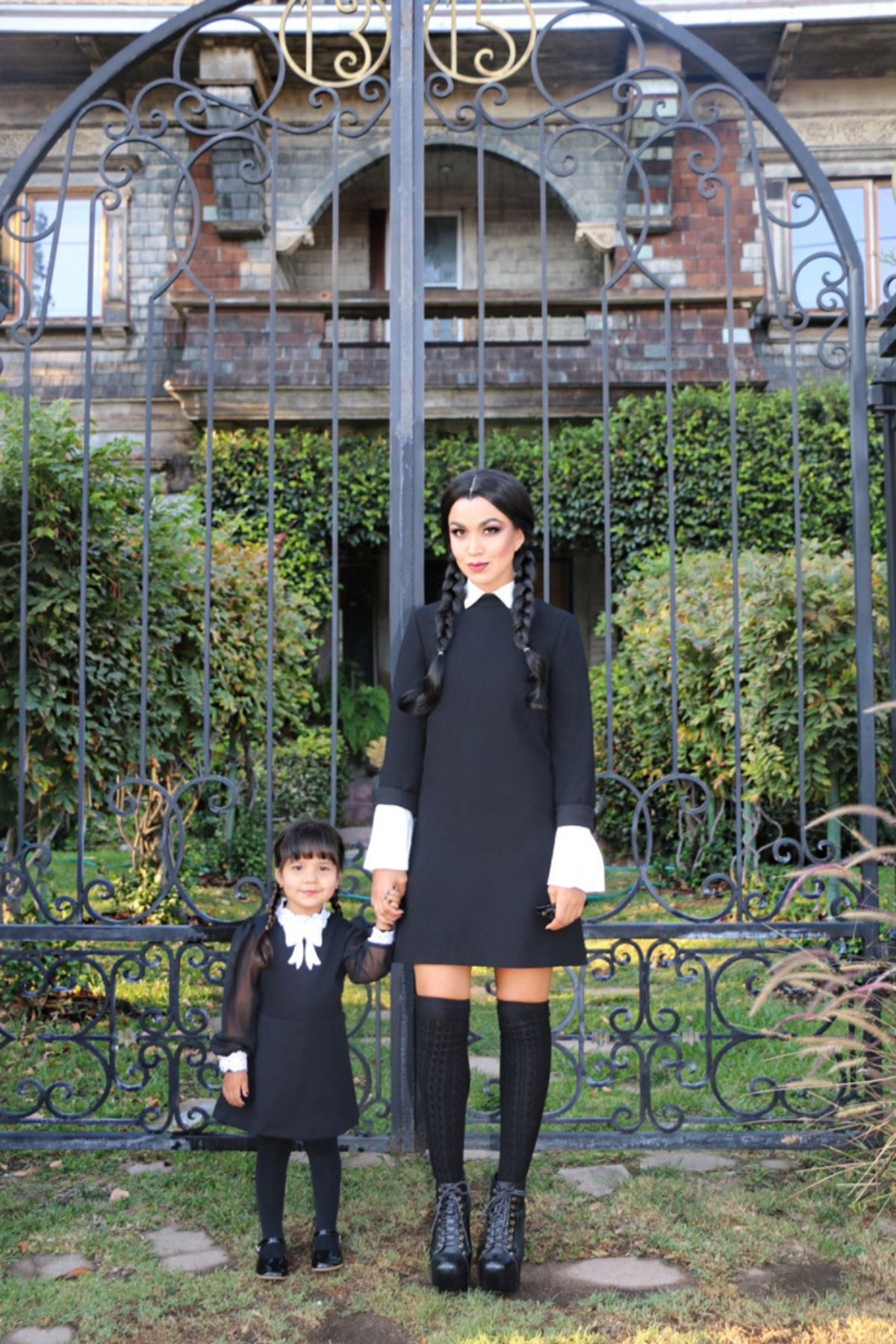mom and daughter both dressed up as Wednesday Addams