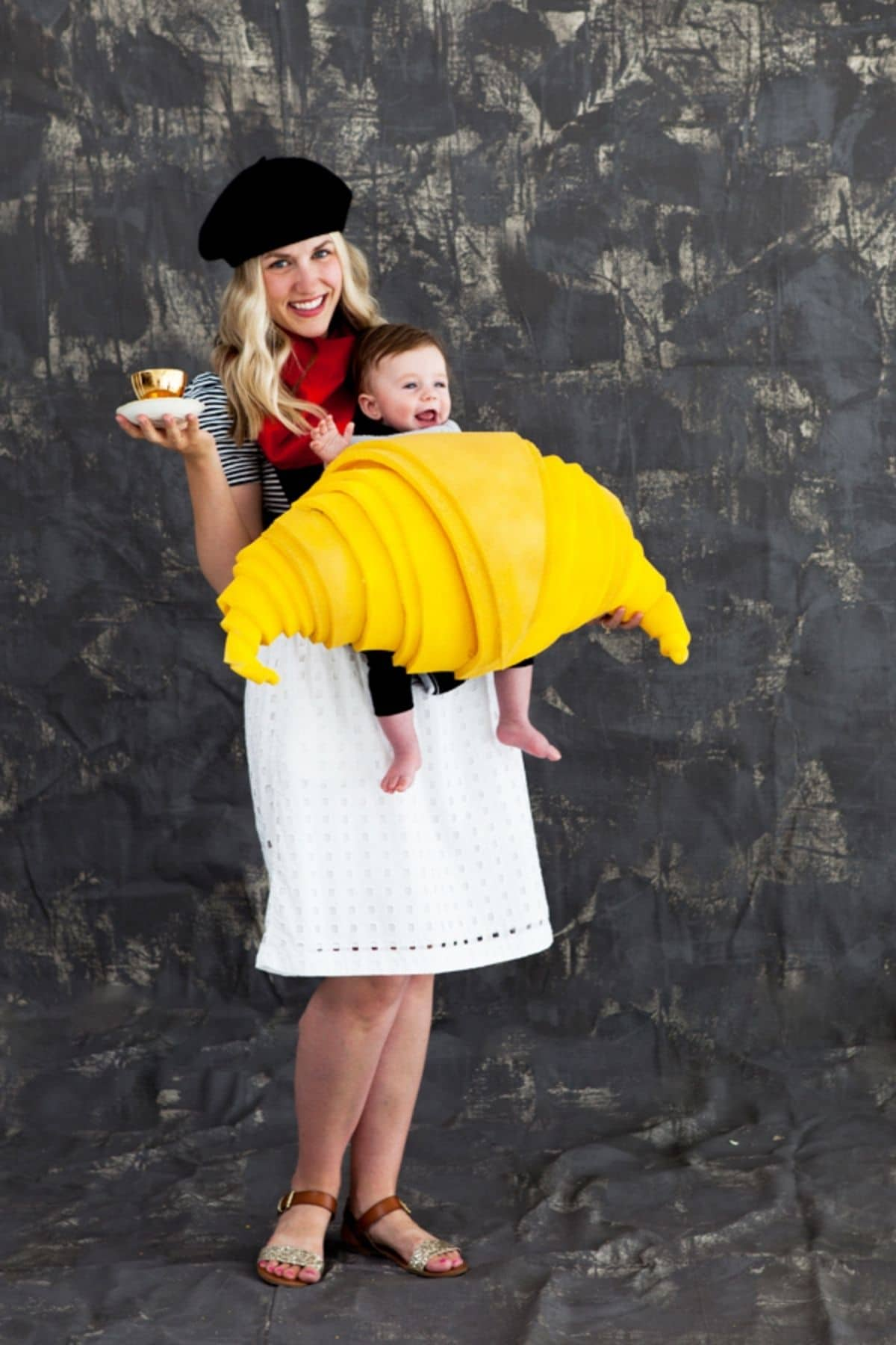 woman dressed up as a french baker and a baby dressed as a croissant