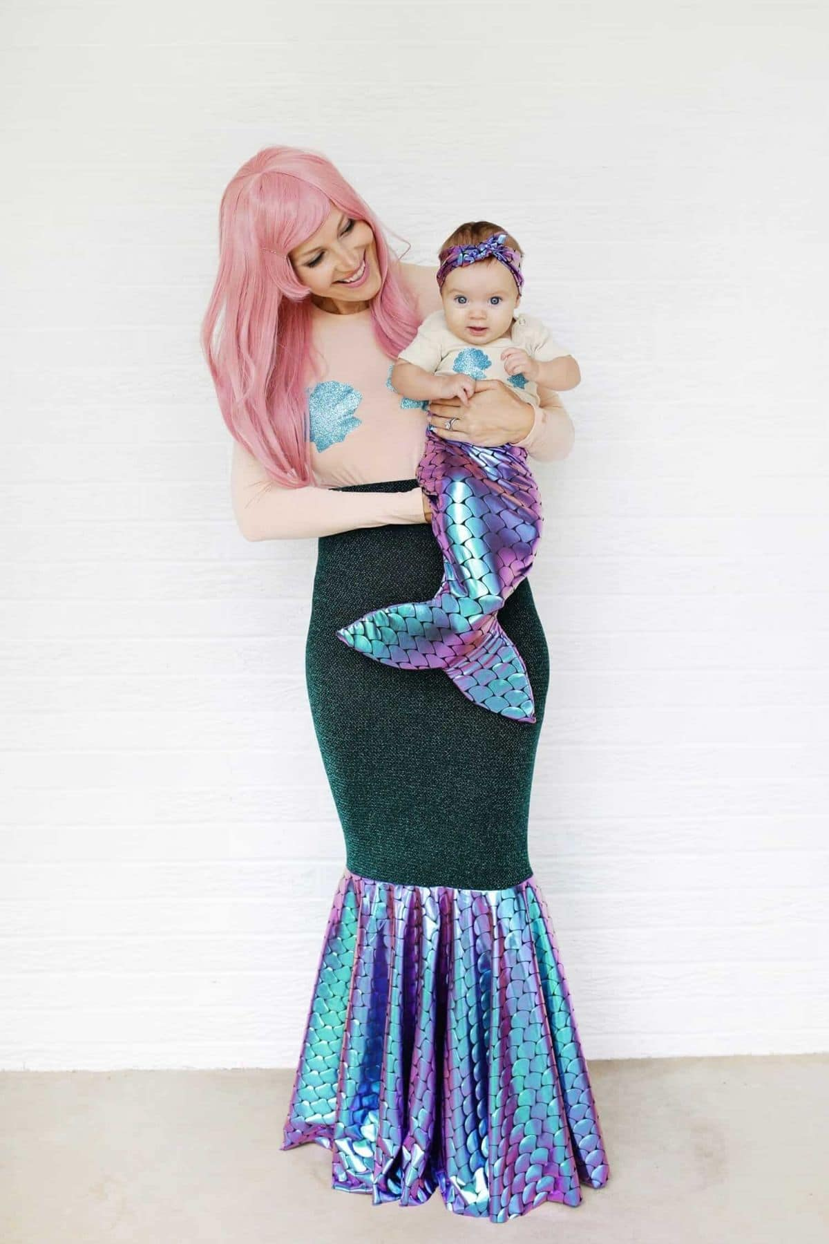 mother and daughter dressed up as mermaids together
