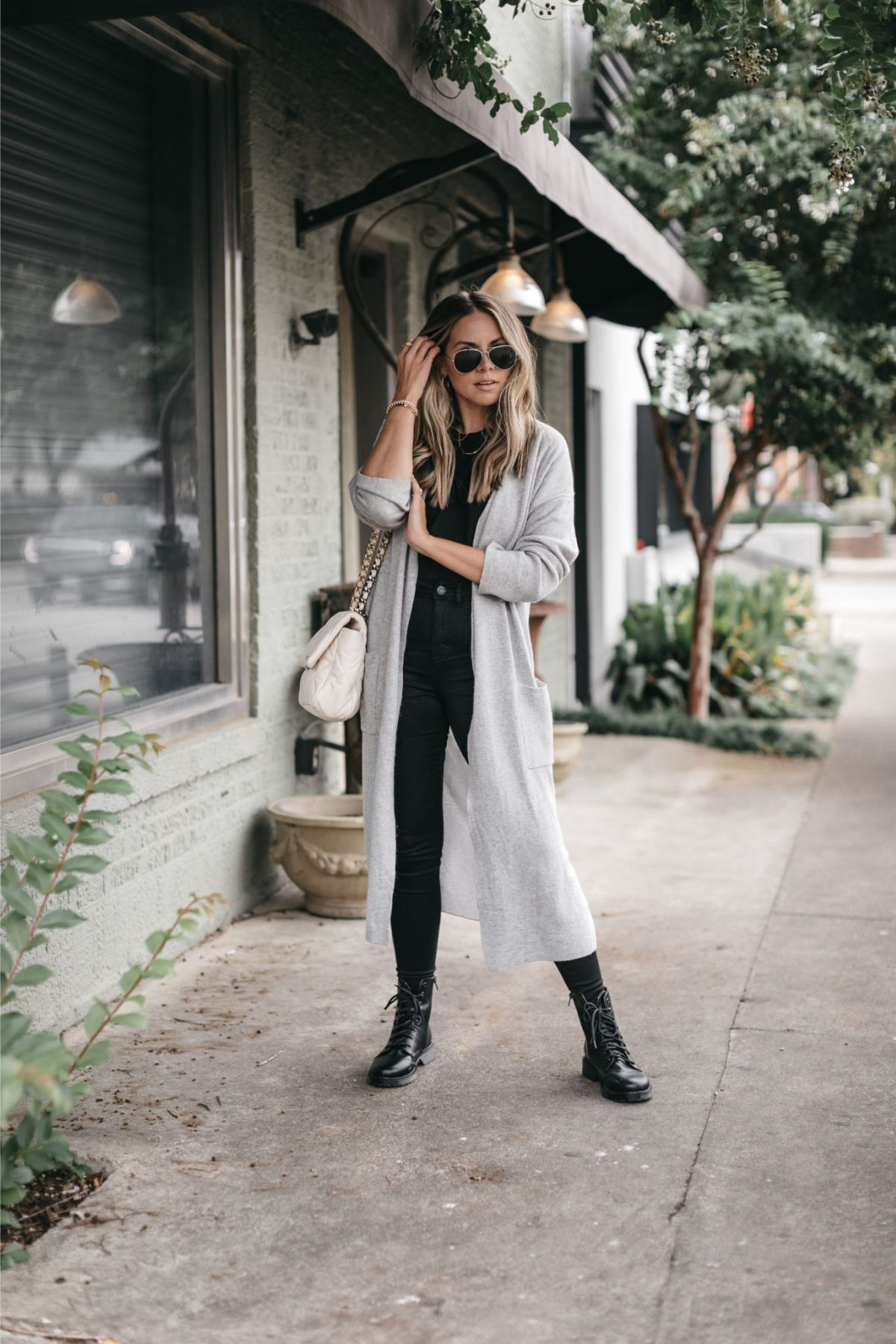 outfit with long cardigan and black pants