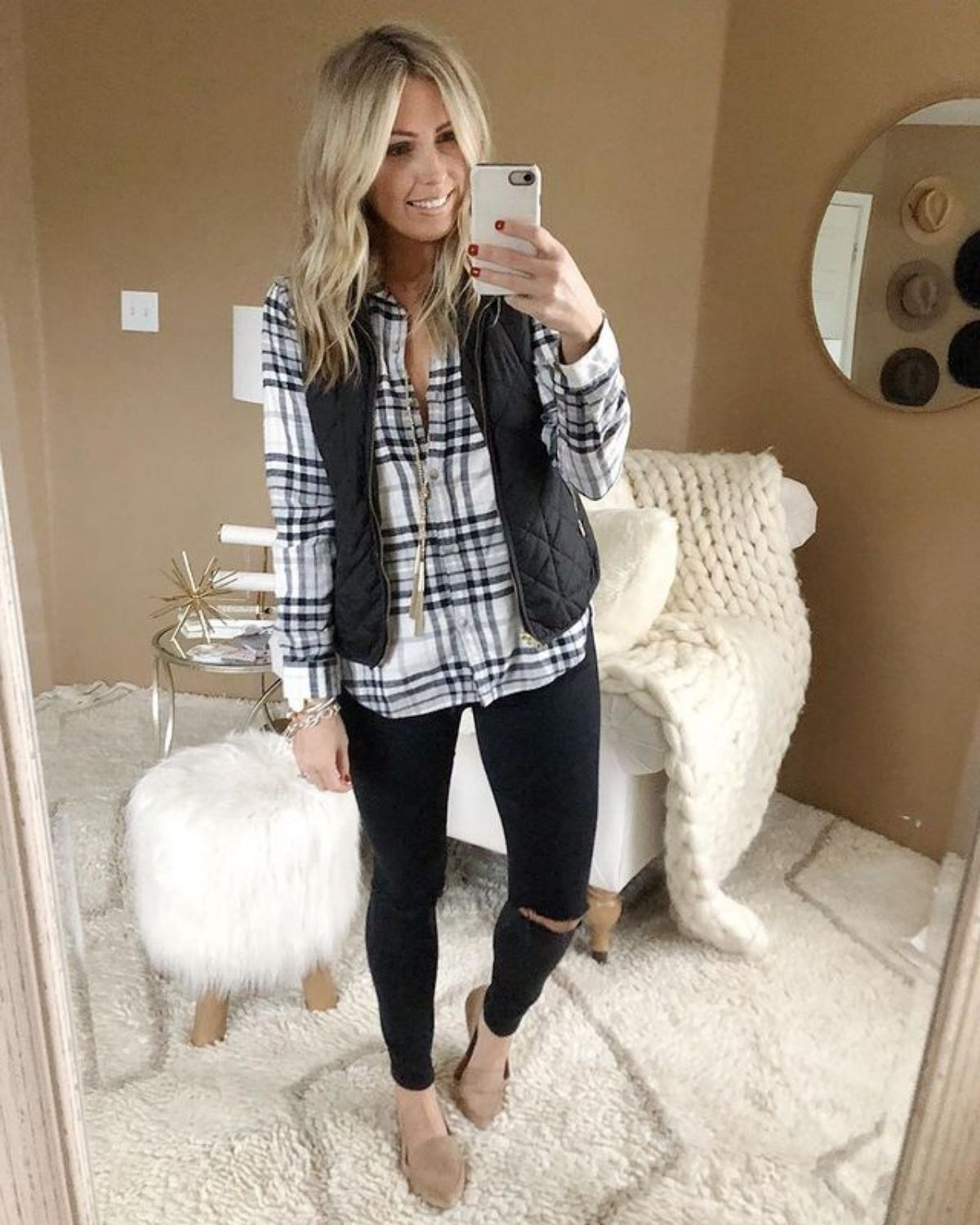 style black jeans with a vest
