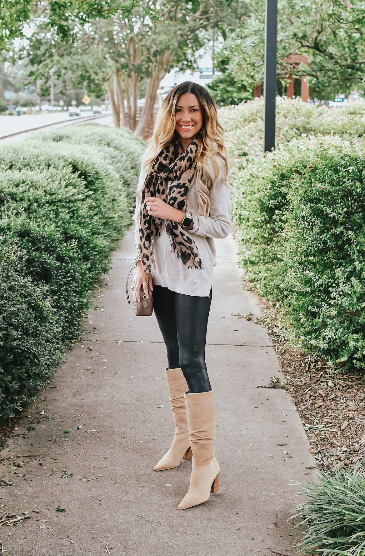 accessorize leather leggings with scarf