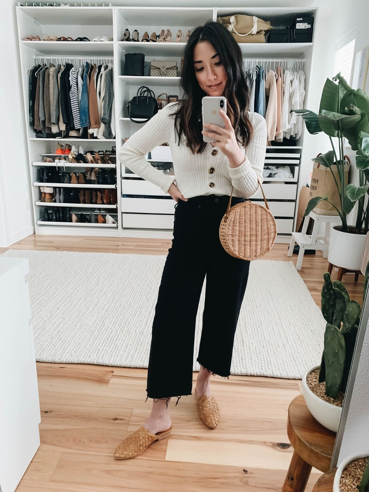 cardigan styled with cropped flare jeans